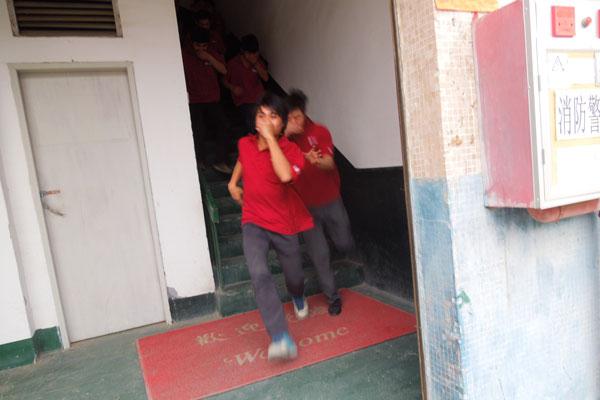 Staff fleeing dorm building
