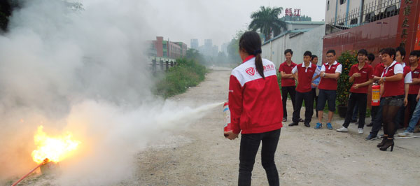 One staff is using the fire extinguishers.